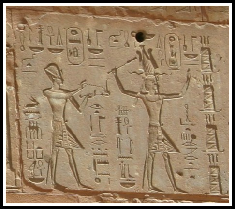 Thutmose III and Hatshepsut- she is the taller figure decked out in Pharaoh garb.
