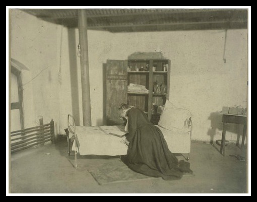 Praying during one of her maaaany days in jail. (Courtesy Kansas Historical Society)