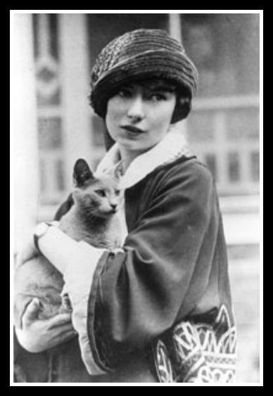 Margaret Mitchell with a fabulous hat...and a cat. (courtesy Media Services News)