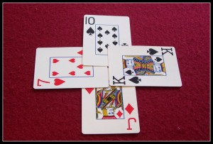 This kind of card trick doesn't have any illusion-coolness...it's just part of the game of Whist