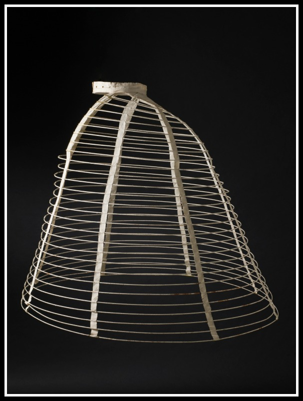 To us- a hoop skirt cage, to Mary a challenge. (this post dates her childhood by a bit, circa 1860s) (wikicommons,)