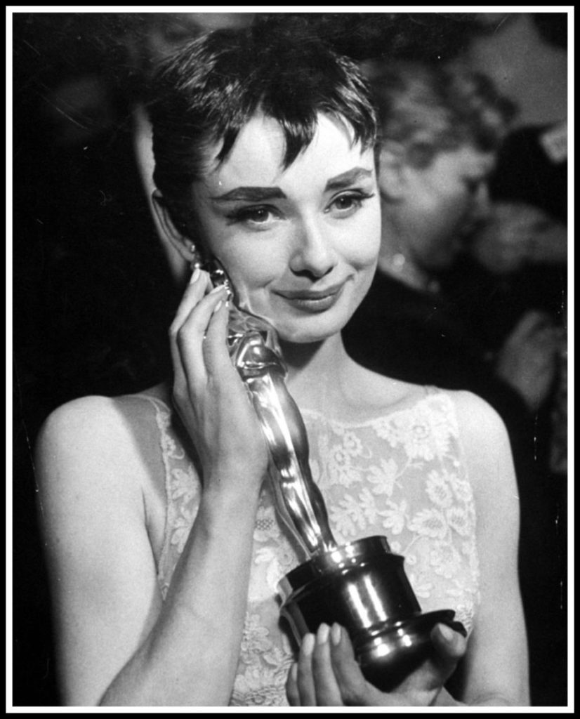 9b3ed43d9d3 Audrey with her Oscar for Roman Holiday in 1954 (either before or after she  left it in the bathroom